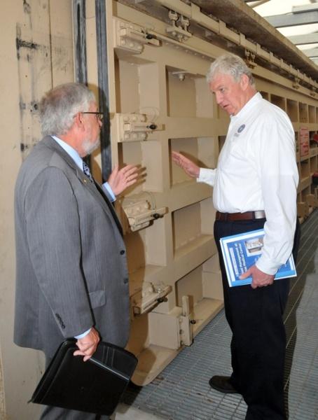 Edgar L. Tucker, Senior VP of Texas Medical Center (left) and FEMA Deputy Administrator Rich Serino (right) discuss a Presray D5B Sliding Flood Door installed at street level to prevent future flooding. Source: FEMA / Earl Armstrong 2012.