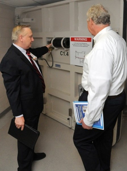 Bert Gumeringer, Dir. of Facilities / Operations and Security at Texas Children's Hospital, show's FEMA Dep. Administrator Rich Serino the operations of a Presray FB77