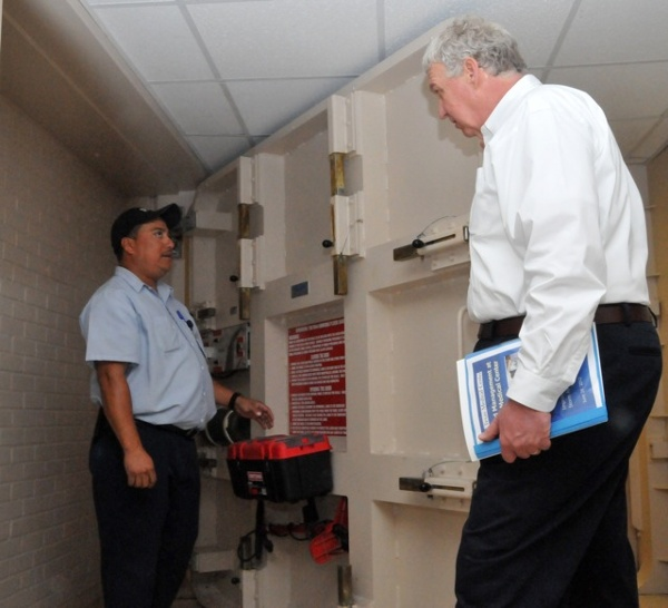 FEMA Dep. Administrator Rich Serino is shown how a Presray FB77 Flood Door, or